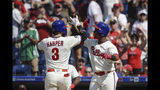 Philadelphia Phillies' Bryce Harper celebrates with Jean Segura after hitting a home run with one run batted in during the sixths inning of a baseball game Sunday, May 19, 2019, in Philadelphia. The Phillies won 7-5. (AP Photo/Matt Rourke)