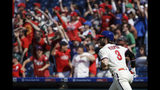 Philadelphia Phillies' Bryce Harper runs to first after hitting a home run with one run batted in during the sixths inning of a baseball game Sunday, May 19, 2019, in Philadelphia. The Phillies won 7-5. (AP Photo/Matt Rourke)