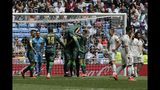Betis players, center, celebrate after scoring their second goal against Real Madrid during a Spanish La Liga soccer match at the Santiago Bernabeu stadium in Madrid, Spain, Sunday, May 19, 2019. (AP Photo/Bernat Armangue)