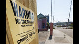 """A """"No Trespassing"""" sign is posted along the fencing protecting the parking lot of the Jackson Women's Health Organization, Friday, May 17, 2019, in Jackson, Miss. The facility is the state's only abortion clinic. (AP Photo/Rogelio V. Solis)"""