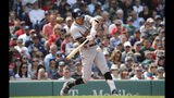 Houston Astros' Carlos Correa hits a two-run home run against the Boston Red Sox during the third inning of a baseball game against the Boston Red Sox, Sunday, May 19, 2019, at Fenway Park in Boston. (AP Photo/Winslow Townson)