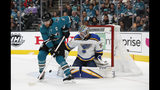 St. Louis Blues goaltender Jordan Binnington (50) makes a save against San Jose Sharks' Joe Pavelski (8) in the first period in Game 5 of the NHL hockey Stanley Cup Western Conference finals in San Jose, Calif., on Sunday, May 19, 2019. (AP Photo/Josie Lepe)