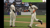 San Francisco Giants' Brandon Crawford, right, is congratulated by Mac Williamson after hitting a solo home run against the Atlanta Braves during the sixth inning of a baseball game in San Francisco, Monday, May 20, 2019. (AP Photo/Jeff Chiu)