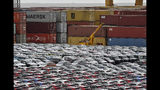 Cars for export and import are stored in front of containers on Thursday, May 16, 2019 at the harbor in Bremerhaven, Germany, with 2 million vehicles per annum one of the largest automobile hubs in the world. US President Donald Trump is delaying any decision to impose tariffs on car and auto-part imports for now. (AP Photo/Martin Meissner)