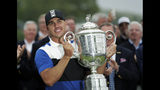 Brooks Koepka holds up the Wanamaker Trophy after winning the PGA Championship golf tournament, Sunday, May 19, 2019, at Bethpage Black in Farmingdale, N.Y. (AP Photo/Julio Cortez)