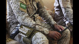 FILE - In this Nov. 28, 2018, file photo, an armed Saudi soldier holds a walkie-talkie near Mukalla, Yemen, at an airport now serving as a military base for the United Arab Emirates. (AP Photo/Jon Gambrell, File)