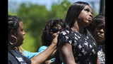 In this Friday, April 20, 2019 photo, Muhlaysia Booker speaks during a rally in Dallas. Booker, a transgender woman seen on a widely circulated video being beaten on April 12 in front of a crowd of people, was found dead Saturday, May 18 in a Dallas shooting. No suspect has been identified. (Ryan Michalesko/The Dallas Morning News via AP)