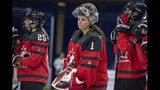 FILE - In this Nov. 10, 2018, file photo, Canada goaltender Shannon Szabados watch as U.S. players celebrate a win during the Four Nations Cup hockey gold-medal game in Saskatoon, Saskatchewan. More than 200 of the world's top female players have taken their next step toward a single, economically viable professional league by forming their own players' association. The new Professional Women's Hockey Association (PWHPA) announced Monday, May 20, 2019, that incorporation papers were filed Friday with help from attorneys from Ballard Spahr. (Liam Richards/The Canadian Press via AP, File)