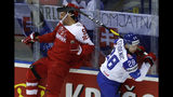 Slovakia's Marian Studenic, right, checks Denmark's Mathias Bau, left, during the Ice Hockey World Championships group A match between Slovakia and Denmark at the Steel Arena in Kosice, Slovakia, Tuesday, May 21, 2019. (AP Photo/Petr David Josek)