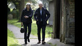 Britain's Prime Minister Theresa May with her husband Philip leave after a church service near her Maidenhead constituency, England, Sunday May 19, 2019. (Andrew Matthews/PA via AP)