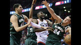 Toronto Raptors center Serge Ibaka (9) battles for the rebound against Milwaukee Bucks forward Nikola Mirotic (41) and Milwaukee Bucks guard Pat Connaughton (24) during the second half of Game 4 of the NBA basketball playoffs Eastern Conference finals, Tuesday, May 21, 2019 in Toronto. (Frank Gunn/The Canadian Press via AP)