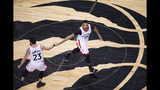 Toronto Raptors forward Norman Powell (24) celebrates his basket with Fred VanVleet (23) during the second half of Game 4 of the team's NBA basketball playoffs Eastern Conference finals against the Milwaukee Buck, Tuesday, May 21, 2019, in Toronto. (Nathan Denette/The Canadian Press via AP)