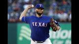 Lance Lynn, abridor de los Rangers de Texas, hace un lanzamiento en el primer episodio del juego del martes 21 de mayo de 2019, ante los Marineros de Seattle (AP Foto/Tony Gutiérrez)