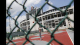 The Ohio State University's football stadium looms above neighboring basketball courts, Saturday, May 18, 2019, in Columbus, Ohio. Dr. Richard Strauss, a now-dead Ohio State team doctor sexually abused at least 177 male students from the 1970s through the 1990s, and numerous university officials got wind of what was going on over the years but did little or nothing to stop him, according to a report released by the school Friday. (AP Photo/John Minchillo)