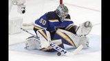 St. Louis Blues goaltender Jordan Binnington blocks a shot against the San Jose Sharks during the third period in Game 6 of the NHL hockey Stanley Cup Western Conference final series Tuesday, May 21, 2019, in St. Louis. (AP Photo/Tom Gannam)