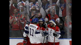 Czech Republic's players and supporters celebrate after scoring during the Ice Hockey World Championships group B match between Czech Republic and Switzerland at the Ondrej Nepela Arena in Bratislava, Slovakia, Tuesday, May 21, 2019. (AP Photo/Ronald Zak)