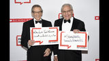 Author Robert Caro, left, and PEN literary service award recipient Bob Woodward pose together holding signs in support of jailed Saudi women's rights activists Nouf Abdulaziz, Loujain Al-Hathloul and Eman Al-Nafjan at the 2019 PEN America Literary Gala at the American Museum of Natural History on Tuesday, May 21, 2019, in New York. (Photo by Evan Agostini/Invision/AP)