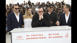 Actors Leonardo DiCaprio, from left, Margot Robbie, director Quentin Tarantino, actor Brad Pitt and producer David Heyman pose for photographers at the photo call for the film 'Once Upon a Time in Hollywood' at the 72nd international film festival, Cannes, southern France, Wednesday, May 22, 2019. (Photo by Vianney Le Caer/Invision/AP)