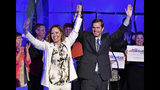 Kentucky Attorney General and Democratic gubernatorial candidate Andy Beshear, right, and his running mate Jacqueline Coleman wave to their supporters following their victory speech in Louisville, Ky., Tuesday, May 21, 2019. (AP Photo/Timothy D. Easley)