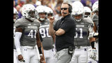 FILE - In this Saturday, Sept. 8, 2018, file photo, Northwestern coach Pat Fitzgerald speaks with his team during a break in the play in an NCAA college football game against Duke, in Evanston, Ill. On the latest AP Top 25 College Football Podcast, Fitzgerald plays it coy with the Wildcats' quarterback competition. He is not ready to hand the job to Hunter Johnson, but the transfer from Clemson could be one of the most-pivotal players in the country. (AP Photo/Jim Young, File)