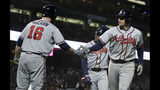 Atlanta Braves' Austin Riley, right, is congratulated by Brian McCann (16) after hitting a three-run home run off San Francisco Giants' Derek Holland during the seventh inning of a baseball game Wednesday, May 22, 2019, in San Francisco. (AP Photo/Ben Margot)