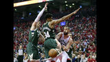 Toronto Raptors center Marc Gasol (33) moves the ball pass Milwaukee Bucks forward Giannis Antetokounmpo (34) during the second half of Game 4 of the NBA basketball playoffs Eastern Conference finals, Tuesday, May 21, 2019 in Toronto. (Frank Gunn/The Canadian Press via AP)