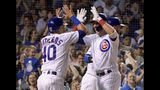 CORRECTS TO FIFTH INNING - Chicago Cubs' Willson Contreras (40) congratulates Albert Almora Jr. (5) on his on his grand slam against the Philadelphia Phillies during the fifth inning of a baseball game Wednesday, May 22, 2019, in Chicago. (AP Photo/Mark Black)