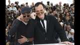 Actor Brad Pitt, left, and director Quentin Tarantino pose for photographers at the photo call for the film 'Once Upon a Time in Hollywood' at the 72nd international film festival, Cannes, southern France, Wednesday, May 22, 2019. (Photo by Vianney Le Caer/Invision/AP)