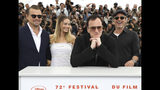 Actors Leonardo DiCaprio, from left, Margot Robbie, director Quentin Tarantino and actor Brad Pitt pose for photographers at the photo call for the film 'Once Upon a Time in Hollywood' at the 72nd international film festival, Cannes, southern France, Wednesday, May 22, 2019. (Photo by Vianney Le Caer/Invision/AP)