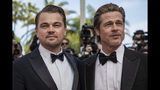 """Actors Leonardo DiCaprio, left, and Brad Pitt pose for photographers at the premiere of their film """"Once Upon a Time in Hollywood"""" at the 72nd international film festival, Cannes, southern France, Tuesday, May 21, 2019. (Photo by Vianney Le Caer/Invision/AP)"""