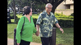 FILE - In this March 12, 2019 file photo, retired Honolulu police chief Louis Kealoha and his wife, former deputy city prosecutor Katherine Kealoha, hold hands while walking to U.S. district court in Honolulu. Opening statements are expected Wednesday, May 22, 2019, after 12 jurors and five alternates are selected for the trial of retired Honolulu police chief Louis Kealoha, his wife and current and former officers. Prosecutors say Kealoha and his former city deputy prosecutor wife, Katherine Kealoha, abused their power to frame a relative for stealing their home mailbox because he threatened to expose financial fraud that funded the couple's lavish lifestyle. (AP Photo/Jennifer Sinco Kelleher, File)