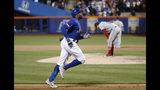 Rajai Davis, de los Mets de Nueva York, recorre las bases después de conectar un jonrón de tres carreras en el octavo inning del juego ante los Nacionales de Washington el miércoles 22 de mayo de 2019 en Nueva York. (AP Foto/Kathy Willens)