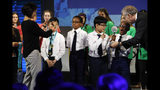 """""""Team Navigators"""" from Flushing Christian School in New York, N.Y., including Natanel Rozic, left, Victor Jimenez, Alex Jun, and Jeremiah Pierre, react after they win in GeoChallenge teams, a new project based competition focused on solutions to plastic pollution, part of the National Geographic GeoBee, Wednesday, May 22, 2019, at National Geographic in Washington. (AP Photo/Jacquelyn Martin)"""