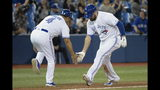 Toronto Blue Jays' Rowdy Tellez, right, celebrates his home run with third base coach Luis Rivera during the 12th inning of a baseball game against the Boston Red Sox on Wednesday, May 22, 2019, in Toronto. (Nathan Denette/The Canadian Press via AP)