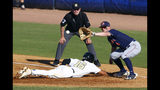 Vanderbilt's Austin Martin (16) dives safely back to first before the throw to Auburn first baseman Rankin Woley (4) during the third inning of a Southeastern Conference tournament NCAA college baseball game Wednesday, May 22, 2019, in Hoover, Ala. (AP Photo/Butch Dill)