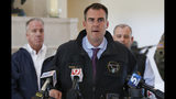 Oklahoma Gov. Kevin Stitt talks with the media following an aerial tour of tornado and flood damaged areas of the state, Tuesday, May 21, 2019, in Oklahoma City. (AP Photo/Sue Ogrocki)