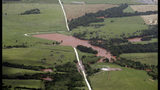 A flooded field is pictured from the air, Tuesday, May 21, 2019, near Geary, Okla. Flooding following heavy rains was an issue across the state. (AP Photo/Sue Ogrocki)