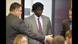 FILE - In this May 20, 2019, file photo, Emanuel Kidega Samson, 27, center, enters the courtroom in Nashville, Tenn. Samson, accused of fatally shooting one person and wounding seven others in a Nashville church in 2017, said Wednesday, May 22, he can't remember if he did it. (George Walker IV/The Tennessean via AP, Pool, File)