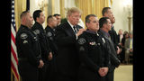 President Donald Trump awards Sgt. Thomas Avila III of the Azusa (Calif.) Police Department the Public Safety Officer Medal of Valor during a ceremony in the East Room of the White House in Washington, Wednesday, May 22, 2019. (AP Photo/Manuel Balce Ceneta)