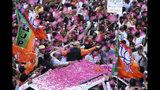 India's ruling Bharatiya Janata Party (BJP) President Amit Shah is showered with flower petals as he arrives at the party office in new Delhi, India, Thursday, May 23, 2019. Indian Prime Minister Narendra Modi's party claimed it had won reelection with a commanding lead in Thursday's vote count, while the stock market soared in anticipation of another five-year term for the pro-business Hindu nationalist leader. (AP Photo/Manish Swarup)