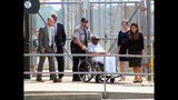 Charles Ray Finch is wheeled out of the Greene Correctional Institution, Thursday, May 23, 2019 in Maury, N.C. Finch, who served more than 40 years in prison for a shopkeeper's slaying in a failed robbery attempt is heading home. A federal judge in Raleigh ordered Finch's release earlier Thursday. In January, an appeals court ruled that evidence casts doubt on Finch's murder conviction. (Drew C. Wilson/The Wilson Times via AP)