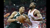 Milwaukee Bucks forward Giannis Antetokounmpo (34) drives to the basket as Toronto Raptors forward Kawhi Leonard (2) defends during the first half of Game 4 of the NBA basketball playoffs Eastern Conference finals, Tuesday, May 21, 2019 in Toronto. (Frank Gunn/The Canadian Press via AP)