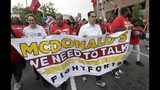 Presidential candidate and former U.S. Department of Housing and Urban Development Julian Castro, second from right, rallies with McDonald's employees and other activists demanding fairer pay, better working conditions, and the right to unionize in Durham, N.C., Thursday, May 23, 2019. (AP Photo/Gerry Broome)