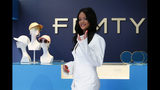 Singer Rihanna, the first black woman in history to head up a major Parisian luxury house, poses as she unveiled her first fashion designs for Fenty at a pop-up store in Paris, France, Wednesday, May 22, 2019. The collection, named after the singer turned designer's last name, comprises ready-to-wear, footwear, accessories, and eyewear and is available for sale Paris' Le Marais area from Friday and will debut online May 29. (AP Photo/Francois Mori)