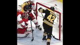 Carolina Hurricanes goaltender Petr Mrazek, second from left, of the Czech Republic, looks back as Boston Bruins' David Backes (42) pokes the puck in for a goal during the third period in Game 2 of the NHL hockey Stanley Cup Eastern Conference final series, Sunday, May 12, 2019 in Boston. (AP Photo/Charles Krupa)