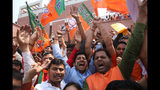 Bharatiya Janata Party (BJP) supporters celebrate their party's victory in the general elections in New Delhi, India, Thursday, May 23, 2019. Indian Prime Minister Narendra Modi's party claimed it had won reelection with a commanding lead in Thursday's vote count, while the stock market soared in anticipation of another five-year term for the pro-business Hindu nationalist leader. (AP Photo/Manish Swarup)