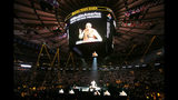 FILE - In this Sept. 28, 2014, file photo, Prime Minister Narendra Modi of India gives a speech during a reception by the Indian community in honor of his visit to the United States at Madison Square Garden, in New York. Modi, 68, the leader of the Hindu nationalist Bharatiya Janata Party, has carefully constructed an image of himself as a pious man of the people, a would-be monk called to politics who has elevated India's status globally and transformed its parliamentary elections from a contest of political parties on social and economic issues into a cult of personality. The cult has been fueled by a social media blitzkrieg. There was NaMo TV and a NaMo app. Like President Donald Trump, to whom he is often compared, Modi is a big fan of Twitter, using it and a YouTube channel managed by the BJP to bypass traditional media. (AP Photo/Jason DeCrow, File)