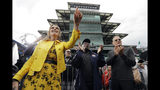 """Savannah Guthrie, Al Roker and Tom Hanks, from left, listen as Sheryl Crow performs on NBC's """"Today"""" show at the Indianapolis Motor Speedway, Thursday, May 23, 2019, in Indianapolis. (AP Photo/Darron Cummings)"""
