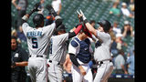 Miami Marlins' Garrett Cooper, right, celebrates with teammates after hitting a grand slam in the ninth inning of a baseball game against the Detroit Tigers in Detroit, Thursday, May 23, 2019. (AP Photo/Paul Sancya)