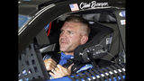 Clint Bowyer waits in his car before practice for Sunday's NASCAR Coca-Cola 600 Cup series auto race at Charlotte Motor Speedway in Concord, N.C., Thursday, May 23, 2019. (AP Photo/Chuck Burton)